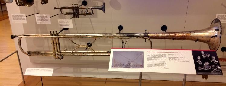 Extra long brass trumpet.